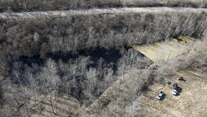 An aerial view of approximately 10,000-gallon crude oil leak in one of Hamilton County park system's four conservation areas, Oak Glen Nature Preserve.