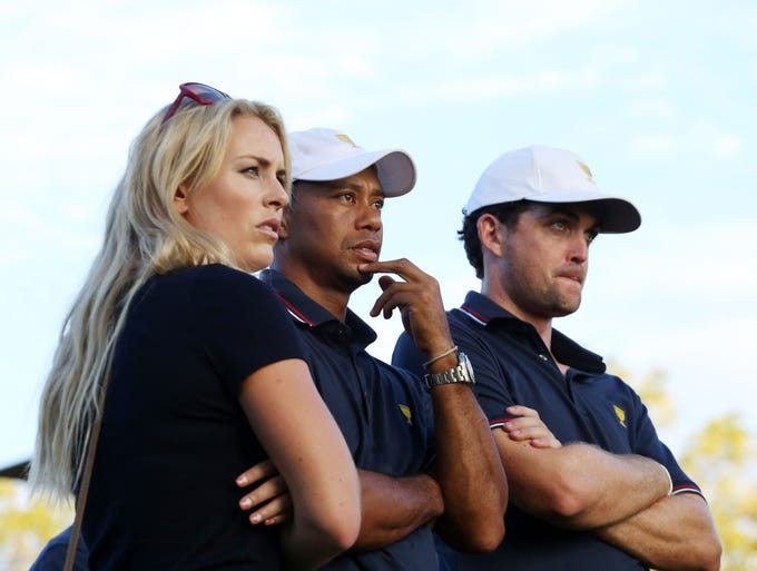 Lindsey Vonn, Tiger Woods and Keegan Bradley watch from the 17th green.
