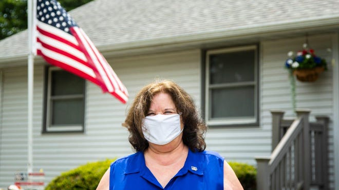 Diana Broderson, mayor of Muscatine, poses for a photo Tuesday while wearing a face mask amid the novel coronavirus pandemic in Muscatine.