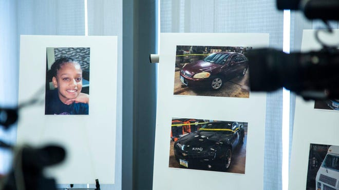 A photo of missing 10-year-old girl Breasia Terrell is displayed alongside images of vehicles owned by a person-of-interest during a news conference Tuesday at the Davenport Police Department in Davenport, Iowa.