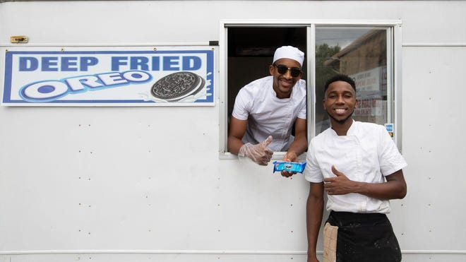 Marquis Williams, left and Demetrius Murray were able to purchase a trailer with the help of a GoFundMe to upgrade themselves from their previous roadside stand for their business selling deep-fried Oreos.