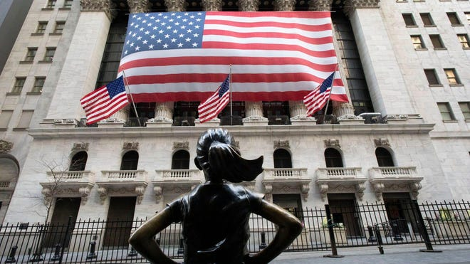 "The ""Fearless Girl"" statute stands in front of the New York Stock Exchange in March."