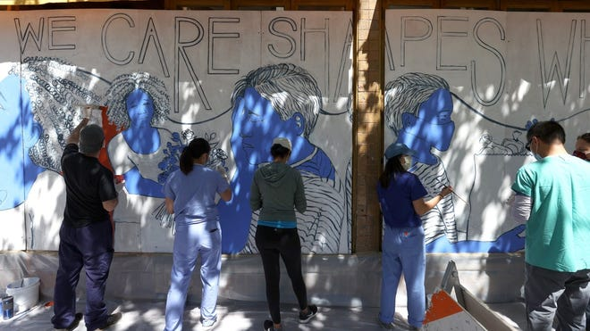 Painting a mural to honor medical workers on June 22 in San Francisco.
