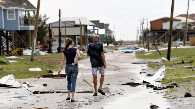Residents take in the widespread destruction in Holly Beach, Louisiana, on Aug. 27, 2020, the day Hurricane Laura hit the Gulf Coast as a Category 4 storm.