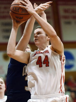 Marist College's Tori Jarosz fights past a Quinnipiac defender on March 27, 2014 at McCann Arena in the Town of Poughkeepsie.
