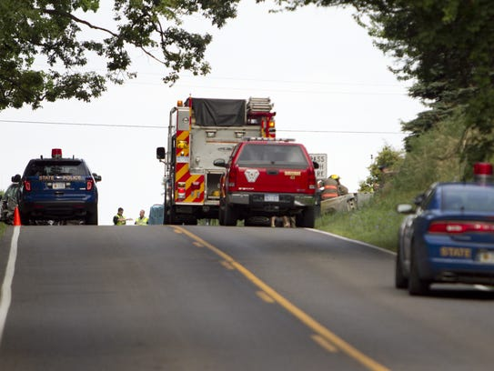 Emergency personnel attend to a fatal accident scene