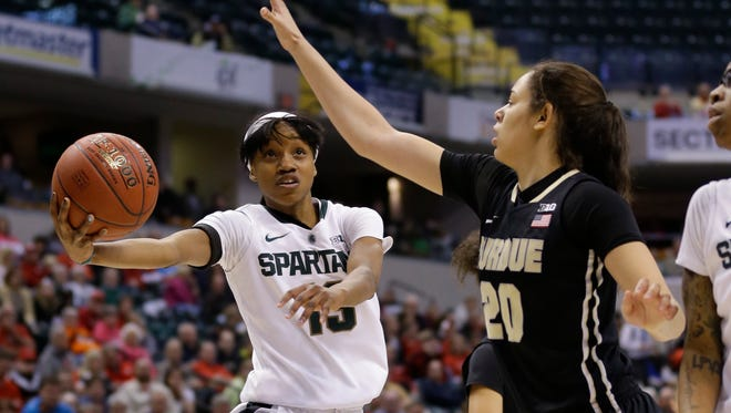 Michigan State guard Morgan Green (13) shoots under Purdue forward Dominique McBryde (20) in the first half of MSU's 65-64 win in the Big Ten tournament Friday in Indianapolis.