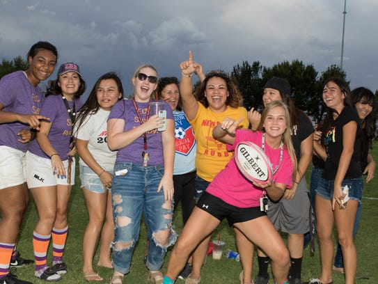 Rugby enthusiasts cheer on their favorite team at the
