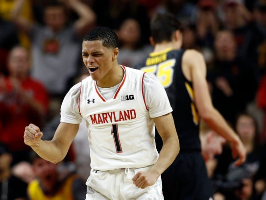 Maryland guard Anthony Cowan reacts after Iowa received