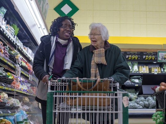 Jackie Lloyd, left, shares a joke with Lois Jones during their shopping trip on Wednesday, Nov. 8 in Royal Oak, Mi. Lloyd, a caretaker for Home Instead Senior Care, has been visiting Jones daily for a little over two years.