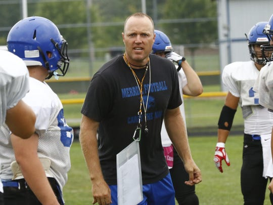 Merrill's head coach Nick Sturm coaches the Bluejays team during Friday boys football scrimmage matchup against West Warriors at Wausau West High School.