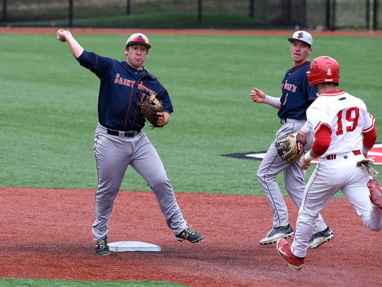 Logan Hershey of St. JohnÕs tries to turn a double play during Friday's game at Becker Park in Collegeville.