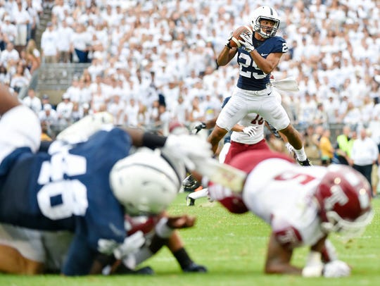 Penn State's John Reid catches an interception in the