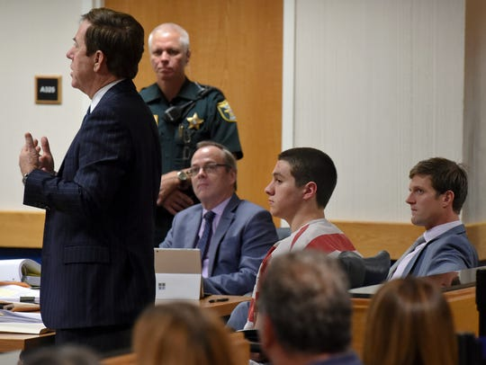 Austin Harrouff (center right) appeared in court Wednesday,