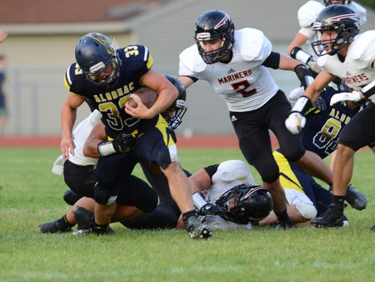Algonac running back Jack Jewell gets taken down during