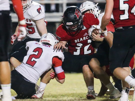 Ballinger's Cooper Bean is tackled by Sonora's Hunter Bunch on Friday, Nov. 3, 2017, at Bearcat Stadium in Ballinger.