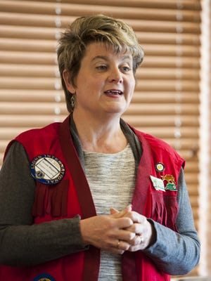 Ronda Wiggers, Vice President of Great Falls Lions Club, addresses club members at Golden Corral Tuesday, Feb. 28.