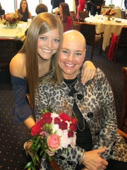 Debutante Catherine K. Humphrey with her mom Cherie Humphrey, who is going through her second round of breast cancer and shaved her head after her first round of chemotherapy.