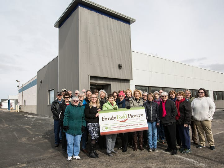 Fondy Food Pantry volunteers stand outside their new
