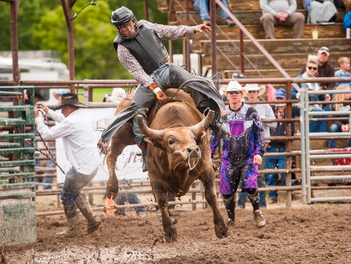 Tucker Zingg competes in the Bull Riding event during
