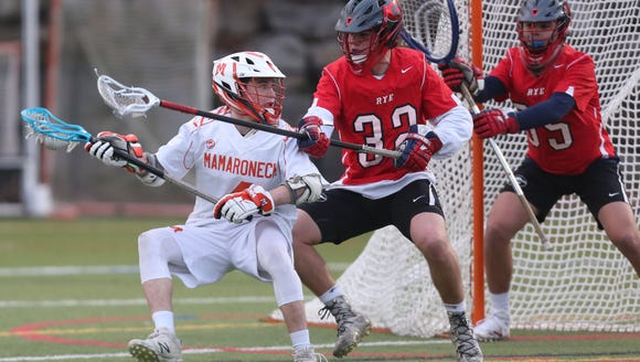 Rye defeated Mamaroneck 12-5 during lacrosse action