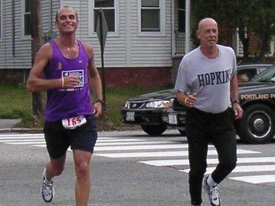 Steve Sponseller, left, and his father Ed Sponseller, right, run in the 2006 Maine Marathon. The two are running together the same year Ed was diagnosed with lymphoma.