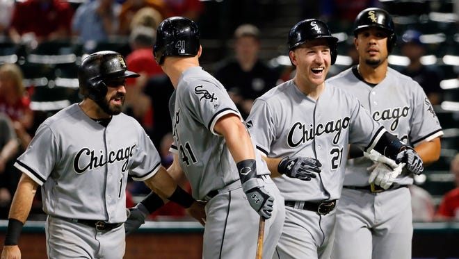 Chicago White Sox's Adam Eaton (1), from left, Jerry Sands (41), Todd Frazier (21) and Jose Abreu, right, celebrate Frazier's grand slam against the Texas Rangers in the 12th inning of a baseball game, Monday, May 9, 2016, in Arlington, Texas.