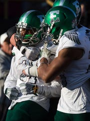 Eastern Michigan receiver Antoine Porter is greeted by teammates after scoring a touchdown against Western Michigan on Oct. 22, 2016.
