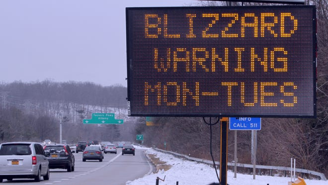 Motorists drive north along the Taconic State Parkway on Jan. 26, as a blizzard was expected to develop later in the day.