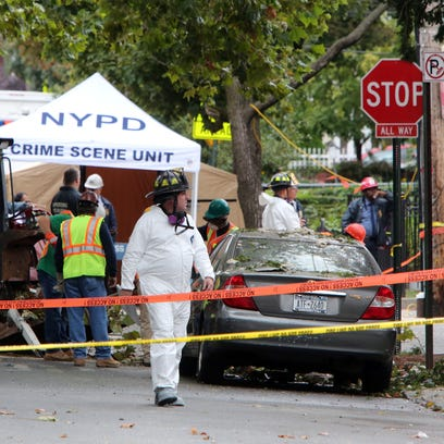 Members of the New York Police Department investigate