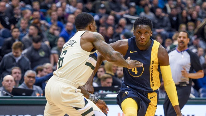 Mar 2, 2018; Milwaukee, WI, USA;  Indiana Pacers guard Victor Oladipo (4) drives for the basket against Milwaukee Bucks guard Eric Bledsoe (6) in the first quarter at the BMO Harris Bradley Center. Mandatory Credit: Benny Sieu-USA TODAY Sports