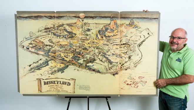 Art dealer Mike Van Eaton stands next to a hand-drawn map from 1953 that shows Walt Disney's original ideas for Disneyland displayed at the Van Eaton Galleries in Sherman Oaks area of Los Angeles on April 28, 2017.