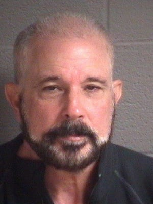 In this March 21, 2015 image provided by the Buncombe County, N.C. Sheriff's Office shows Jose Lantigua. Lantigua, 62, reported dead two years ago in Venezuela, was arrested in North Carolina on alleged fraud charges Saturday, March 21, 2015, after his life insurance companies filed a lawsuit alleging he was alive and they shouldn't be making payments. (AP Photo/Buncombe County, (N.C.) Sheriff's Office)
