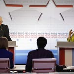 Sen. Bernie Sanders, I-Vt., and Hillary Clinton argue a point during a Democratic presidential primary debate at the University of Wisconsin-Milwaukee on Thursday.