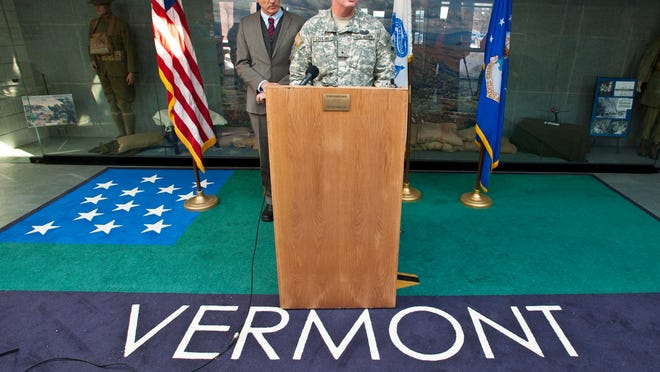 Brig. Gen. Mark Lovejoy speaks at a news conference at Camp Johnson in Colchester on Wednesday after an announcement that a detachment of Vermont National Guard soldiers and their equipment will be heading down to Massachusetts to help with snow removal. Gov. Peter Shumlin is at left.