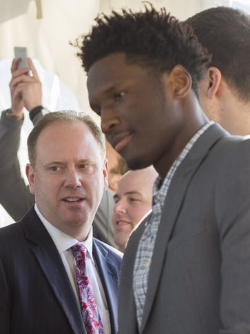 Wisconsin head basketball coach Greg Gard, left, talks with Nigel Hayes, center, and Ethan Happ, right, as they arrive at Kohler Company's corporate aviation hangar for the fifth annual Wisconsin Sports Awards.
