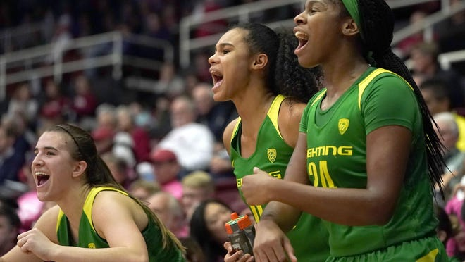 "The other two members of Oregon's ""Big Three,"" Satou Sabally, center, and Ruthy Hebard, right, made their WNBA debuts on Sunday after Sabrina Ionescu, left, played her first professional game on Saturday."