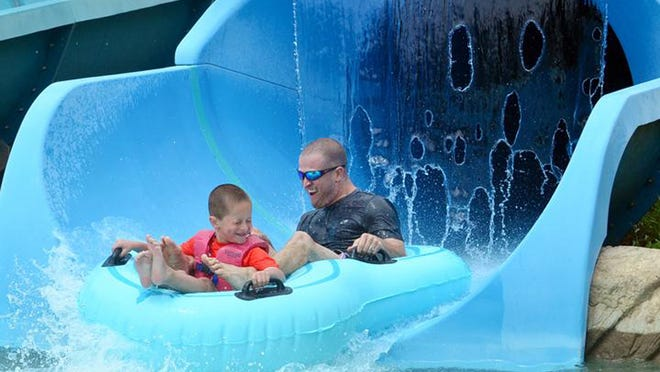 A view from a previous year at Roseland Waterpark in Canandaigua, as a father and son ride on the Extreme Tube Ride.