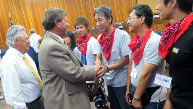 St. George City Councilman Gil Almquist and other officials welcomed a delegation of runners and government officials from Ibigawa, Japan, during a meeting Oct. 1, 2015.