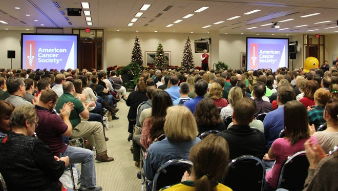 Acuity employees listen as CEO and President Ben Salzmann details what charities they'll be voting on at a town hall meeting on Thursday, Dec. 10.