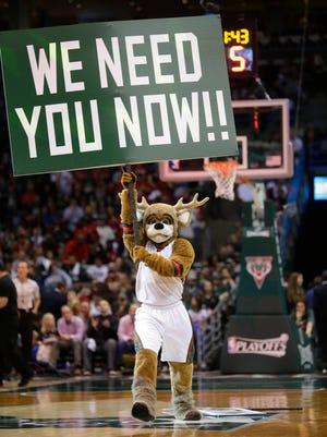 Bango, the Bucks' mascot, rallies fans at the BMO Harris Bradley Center during a game last season.