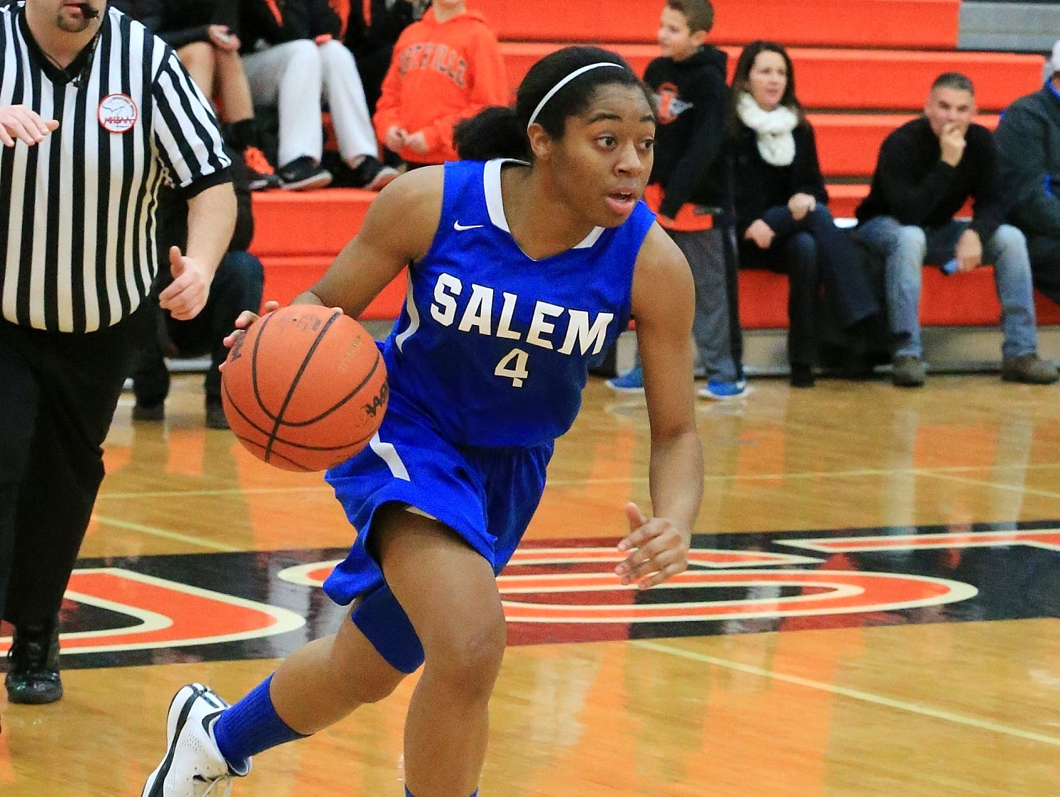 Bringing the ball up court during a recent game is Salem senior guard Jamyra Wilson.