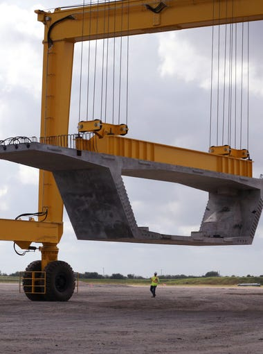 A segment that will be used to build the new Harbor Bridge is moved to a curing location at the Flatiron/Dragados, LLC Pre-Cast Yard on Friday, Oct. 6, 2017. Each segment weighs 100 tons.