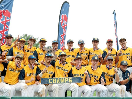 The Hartland baseball team poses for photos after getting