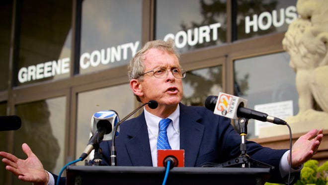 Ohio Attorney General Mike DeWine speaks to the media Aug. 19  at the Greene County courthouse in Dayton.