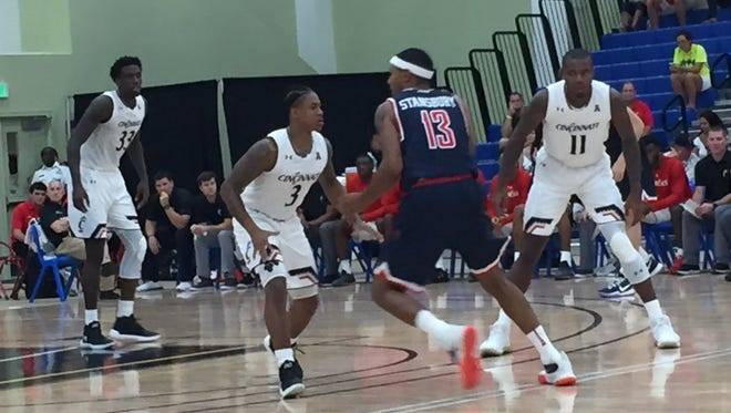 University of Cincinnati players (left to right) Nysier Brooks, Justin Jenifer and Gary Clark push the defense out high against Richmond on Tuesday night, in the Cayman Islands Classic.
