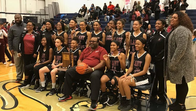 Tindley's girls basketball team poses after winning a sectional title on Saturday.