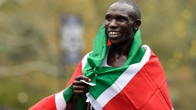 Geoffrey Kamworor celebrates after winning the Professional Men's division.