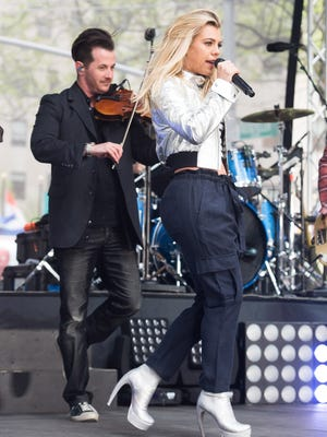 """Jason Fitz performs along with Kimberly Perry from The Band Perry on NBC's """"Today"""" show at Rockefeller Plaza on Wednesday, April 27, 2016, in New York."""