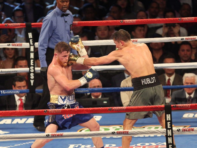 "Saul ""Canelo"" Alvarez, in blue with white stripe trunks,"